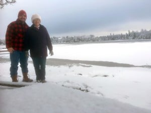 Previous owner Lin Sherfy and new owner Carl Madsen standing next to Poplar lake